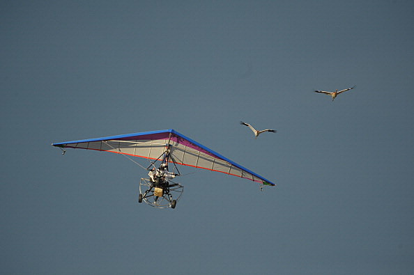 President of Russia Vladimir Putin (front) and a copilot in a motorized hang glider